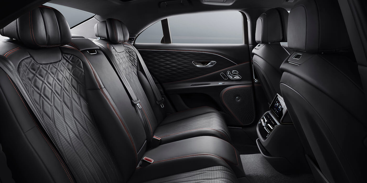 new-Bentley-Flying-Spur-V8-rear-interior-in-Beluga-black-quilted-leather